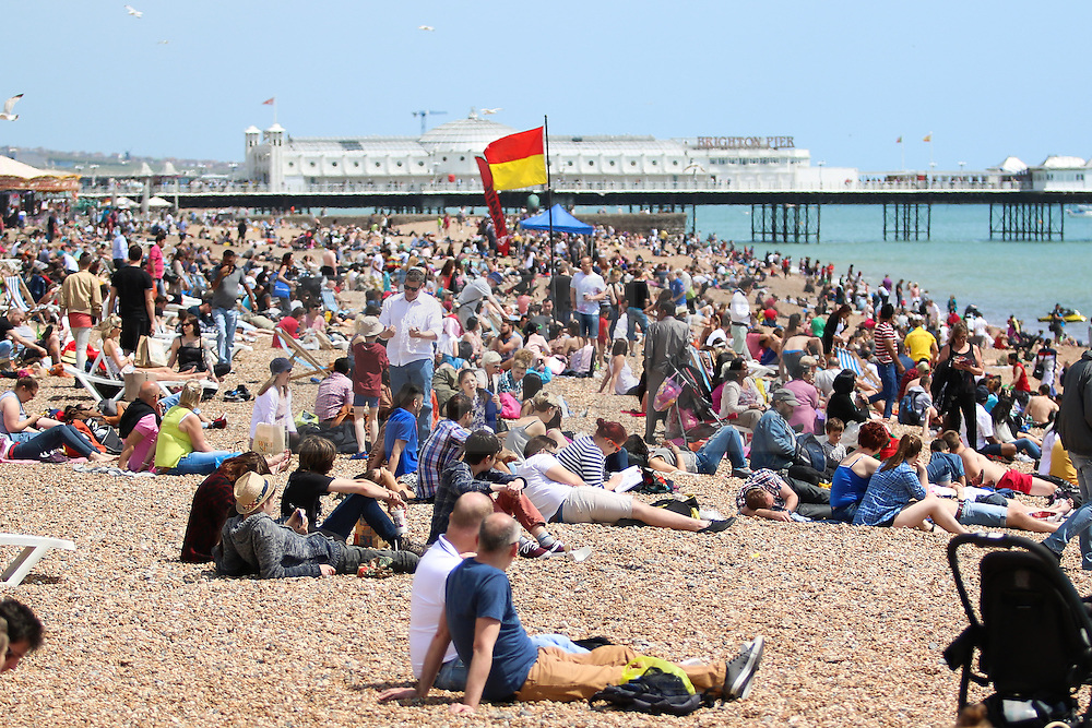 © Licensed to London News Pictures. 07/06/2015. Brighton, UK. Thousands of people are sunbathing on the beach in Brighton as temperatures are expected to be some of the hottest of the year so far. today June 7th 2015. Photo credit : Hugo Michiels/LNP