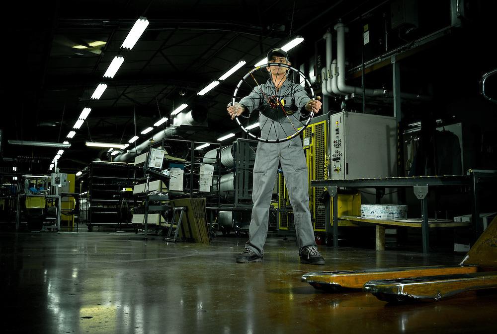 Wheel engineer at the Mavic wheel factory, France.