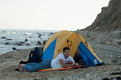 rugged man camping at the beach in Montauk, NY