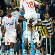 Marseille's Morgan Amalfitano wetm team mates celebrates his goal during their UEFA Europa League Group Stage Group C soccer match Fenerbahce between Marseille at Sukru Saracaoglu stadium in Istanbul Turkey on Thursday 20 September 2012. Photo by TURKPIX