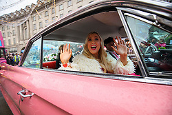 © Licensed to London News Pictures. 20/11/2016. London, UK. A woman dressed as Barbie waves at children as over 400 cast members of Hamley's Toy Parade march along Regent Street in London in a colourful extravaganza, with marching bands, dancers and toy vehicles. Photo credit: Tolga Akmen/LNP