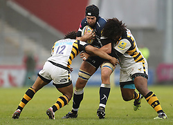 Sale's Josh Beaumont is tackled by Wasps' Kyle Eastmond and Ashley Johnson during the Aviva Premiership match at the AJ Bell Stadium, Sale.