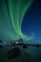 Northern lights - Aurora Borealis fill sky over Myrland beach, Flakstadøy, Lofoten Islands, Norway