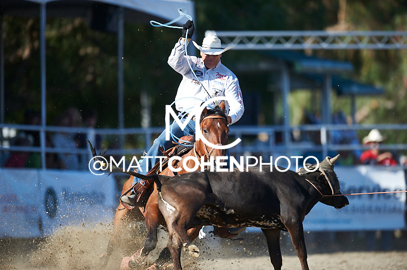Team roper Clay O'Brien Cooper of Gardnerville, NV competes at the Rancho Mission Viejo Rodeo in San Juan Capistrano, CA.<br /> <br /> <br /> UNEDITED LOW-RES PREVIEW<br /> <br /> <br /> File shown may be an unedited low resolution version used as a proof only. All prints are 100% guaranteed for quality. Sizes 8x10+ come with a version for personal social media. I am currently not selling downloads for commercial/brand use.