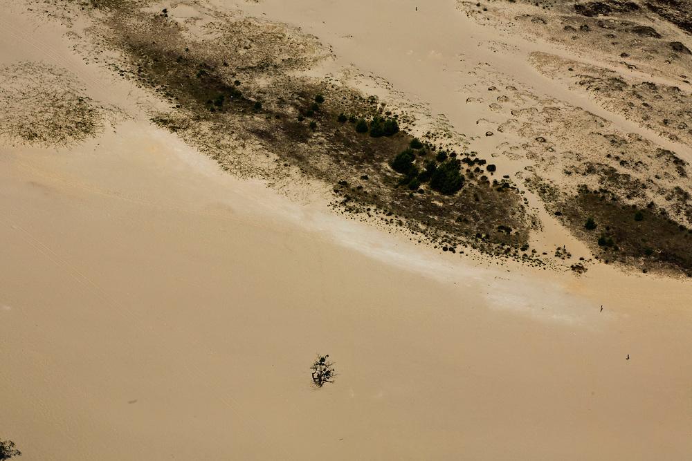Nederland, Noord-Brabant, Gemeente Loon op Zand, 08-07-2010; Nationaal Park De Loonse en Drunense Duinen. Kenmerkend voor het gebied van de Loonsche en Drunensche Duinen is het stuifzandlandschap afgewisseld met naaldbos, bestaande uit stuifzanden en ondergestoven boomkruinen. In beheer bij Vereniging Natuurmonumenten en Het Brabants Landschap.Mad made landscape of drift-sand or shifting sands landscape with characteristic dunes..luchtfoto (toeslag), aerial photo (additional fee required).foto/photo Siebe Swart