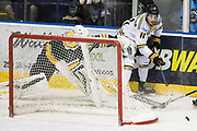 Victoria Grizzlies Justin Michaelian strips Powell River Goaltender Brian Wilson of the puck at the Q Centre in  Colwood, British Columbia Canada on March 27, 2017.