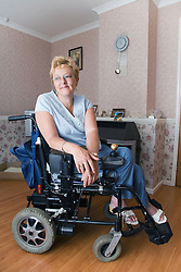 Portrait of a woman in wheelchair; smiling,