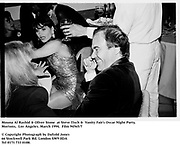 Mouna Al Rashid & Oliver Stone  at Steve Tisch &  Vanity Fair's Oscar Night Party,<br />Mortons,  Los Angeles. March 1994.  Film 94565/7<br /> <br />© Copyright Photograph by Dafydd Jones<br />66 Stockwell Park Rd. London SW9 0DA<br />Tel 0171 733 0108.