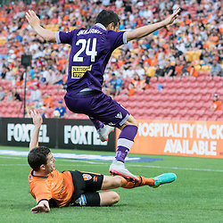 BRISBANE, AUSTRALIA - OCTOBER 30: Tommy Oar of the roar tackles Milan Smiljanic of the Glory during the round 4 Hyundai A-League match between the Brisbane Roar and Perth Glory at Suncorp Stadium on October 30, 2016 in Brisbane, Australia. (Photo by Patrick Kearney/Brisbane Roar)