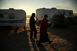 November 25, 2016 - Cannon Ball, North Dakota, U.S - Water protectors walk through the Oceti Sakowin Camp at the Standing Rock Indian Reservation in Cannon Ball, North Dakota. (Credit Image: © Joel Angel Ju‡Rez via ZUMA Wire)