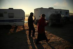 November 25, 2016 - Cannon Ball, North Dakota, U.S - Water protectors walk through the Oceti Sakowin Camp at the Standing Rock Indian Reservation in Cannon Ball, North Dakota. (Credit Image: © Joel Angel Ju‡Rez via ZUMA Wire)