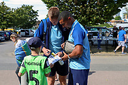 AFC Wimbledon striker Joe Pigott (39)and AFC Wimbledon striker Kweshi Appiah (9)signing autographs during the EFL Sky Bet League 1 match between AFC Wimbledon and Wycombe Wanderers at the Cherry Red Records Stadium, Kingston, England on 31 August 2019.