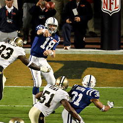 2010 February 07: Indianapolis Colts quarterback Peyton Manning (18) is hit by New Orleans Saints defensive end Bobby McCray (93) during a 31-17 win by the New Orleans Saints over the Indianapolis Colts in Super Bowl XLIV at Sun Life Stadium in Miami, Florida.