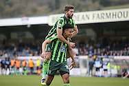 Lyle Taylor of AFC Wimbledon celebrates after scoring his teams 2nd goal scoring from a penalty to make it 1-2 with George Francomb (top) of AFC Wimbledon. Skybet football league two match, Wycombe Wanderers  v AFC Wimbledon at Adams Park  in High Wycombe, Buckinghamshire on Saturday 2nd April 2016.<br /> pic by John Patrick Fletcher, Andrew Orchard sports photography.