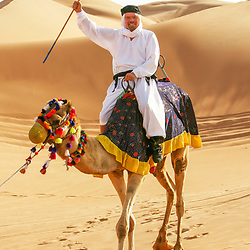 PIC BY PAUL GROVER IN DUBAI WHERE VIRGIN ATLANTIC FLEW FOR THE FIRST TIME ON ITS DUBAI INAUGURAL PIC SHOWS RICHARD BRANSON in the desert PIC PAUL GROVER