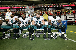 Philadelphia Eagles offensive tackle Jamaal Jackson #67, offensive tackle Todd Herremans #79, and offensive tackle Jason Peters #71 on the bench before the NFL game between the Philadelphia Eagles and the Atlanta Falcons on December 7th 2009. The Eagles won 34-7 at The Georgia Dome in Atlanta, Georgia. (Photo By Brian Garfinkel)