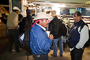 28 NOVEMBER 2006 - SAN LUIS, AZ: Farm workers stand in line to enter the US at the Port of Entry in San Luis, AZ, about 20 miles south of Yuma. Farmers and agricultural producers around Yuma, AZ, are facing a growing shortage of farm workers. Increased border enforcement have deterred many illegal workers from seeking work in Arizona and long lines at the ports of entry for legal workers are leading to the labor shortage. Some labor contractors are reporting as much as a 40 percent shortage of farm workers, Yuma farmers planted 15 percent fewer acres this year, compared to last, because of the shortage. More than 100,000 acres of iceberg lettuce are cultivated in Yuma county and more than 50,000 people are employed as seasonal farm workers at the height of the harvest, which is December through February. Nearly 3,500 seasonal farm workers stand in line for up to two hours every morning at the San Luis, AZ, Port of Entry to enter the US legally to work in the fields. Experienced workers can make as much as $14 (US) per hour during the harvest. Photo by Jack Kurtz/ZUMA Press