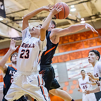 Gallup Bengal Tyrell Begay (23) attempts a put-back from a rebound ahead of Aztec Tiger Cody Smith (11) at Gallup High School Friday.