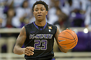 FORT WORTH, TX - JANUARY 7: Nigel Johnson #23 of the Kansas State Wildcats brings the ball up court against the TCU Horned Frogs on January 7, 2014 at Daniel-Meyer Coliseum in Fort Worth, Texas.  (Photo by Cooper Neill/Getty Images) *** Local Caption *** Nigel Johnson