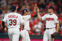 October 5, 2017 - Cleveland, OH, UKR - Cleveland Indians pitcher Trevor Bauer, right, high-fives infielders Giovanny Ursula (39) and Francisco Lindor as he leaves the game in the seventh inning against the New York Yankees in Game 1 of the American League Division Series on Thursday, Oct. 5, 2017, at Progressive Field in Cleveland. (Credit Image: © Leah Klafczynski/TNS via ZUMA Wire)