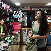 Bra shopping in Glamour in Hamra district on her way to work. Dima, former dancer from Damascus now working in Mezzian in Beirut. She came 15 months ago fleeing threats to kill and rape her from the Ghosts - Assad regime fanatics. She has not danced since but misses it a lot.