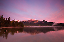 Sunrise at Pyramid Lake, Pyramid Mountain is reflection in its waters in Jasper  National Park