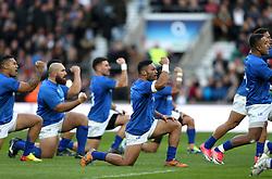 Samoa players perform the haka before the Autumn International at Twickenham Stadium, London.