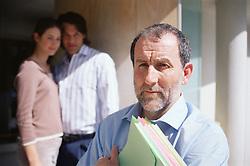 Dec. 14, 2012 - Financial adviser with couple (Credit Image: © Image Source/ZUMAPRESS.com)