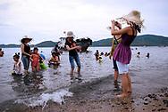 Vietnamese family enjoy vacations on a beach of Nha Trang, Vietnam, Southeast Asia