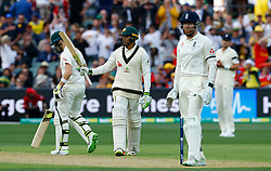 Australia's Usman Khawaja celebrates his fifty as Jonny Bairstow looks on during day one of the Ashes Test match at the Adelaide Oval, Adelaide.
