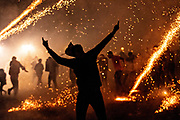 A Mexican man celebrates as dozens of sky rockets explode around him in the chaos of the Alborada festival September 29, 2018 in San Miguel de Allende, Mexico. The unusual festival celebrates the cities patron saint with a two hour-long firework battle at 4am representing the struggle between Saint Michael and Lucifer.