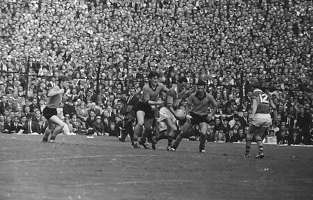 Kerry player attempts to run from two down players close by during the All Ireland Senior Gaelic Football Final Kerry v Down in Croke Park on the 22nd September 1968. Down 2-12 Kerry 1-13.