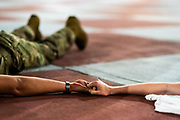 Knobs from Band Company hold hands after completing The Gauntlet, the final, most grueling physical training exercise before being recognized as full members of the South Carolina Corps of Cadets, on Friday, March 13, 2020. <br /> <br /> Credit: Cameron Pollack / The Citadel
