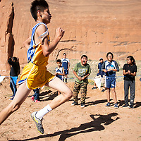 A runner from Zuni gets encouragement from the sidelines at the Curtis Williams Invitational, Saturday Oct. 6, 2018 at Red Rock Park in Church Rock.