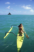Woman in outrigger canoe, Kaneohe Bay, Oahu, Hawaii<br />
