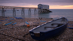 © Licensed to London News Pictures. 26/10/2016. Selsey, UK. Dawn light at Selsey Lifeboat Station this morning, 26th October 2016. The current station, re-built in 1958, currently houses the 'Betty and Thomas Moore' D-Class lifeboat. The station has a history of over 150 years of active lifeboat service. Photo credit: Rob Arnold/LNP