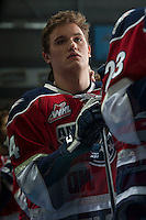 KELOWNA, CANADA - MARCH 8: Jackson Playfair #24 of the Tri-City Americans stands on the bench during the national anthem against the Kelowna Rockets on March 8, 2014 at Prospera Place in Kelowna, British Columbia, Canada.   (Photo by Marissa Baecker/Getty Images)  *** Local Caption *** Jackson Playfair;