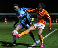 Blackpool's Armand Gnanduillet keeps the ball in play under pressure from Wycombe Wanderers' Anthony Stewart<br /> <br /> Photographer Lee Parker/CameraSport<br /> <br /> The EFL Sky Bet League One - Wycombe Wanderers v Blackpool - Tuesday 28th January 2020 - Adams Park - Wycombe<br /> <br /> World Copyright © 2020 CameraSport. All rights reserved. 43 Linden Ave. Countesthorpe. Leicester. England. LE8 5PG - Tel: +44 (0) 116 277 4147 - admin@camerasport.com - www.camerasport.com