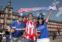Fans pose with a half and half scarf ahead of the game