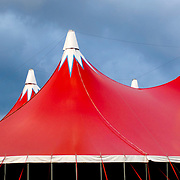 raised red canopy tent with stormy sky background
