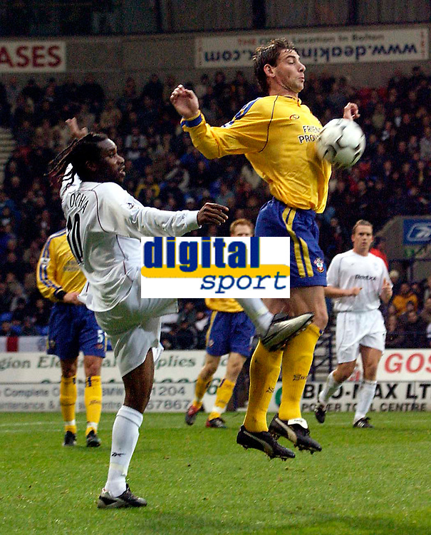 Photo. Jed Wee.<br /> Bolton Wanderers v Southampton, FA Barclaycard Premiership, Reebok Stadium, Bolton. 08/11/03.<br /> Southampton's Rory Delap (R) beats Bolton's Jay Jay Okocha to the ball.