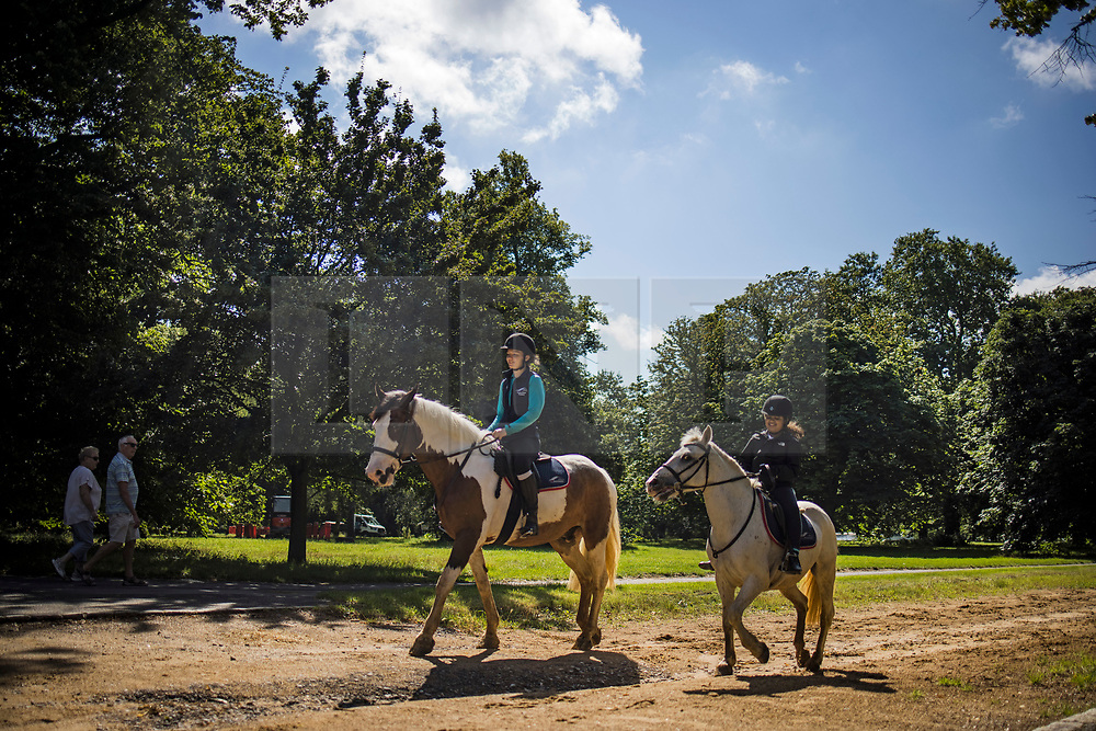 © Licensed to London News Pictures. 10/08/2021. Horse riders in warm conditions in Hyde Park, central London on a warm summer's day. A period of warmer conditions is expected across the UK following several days of torrential rain. Photo credit: Ben Cawthra/LNP