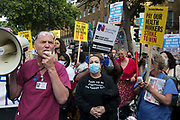 Staff nurse David Carr addresses NHS staff who marched from St Thomas Hospital and UCH to Downing Street to protest against the NHS Pay Review Bodys recommendation of a 3% pay rise for NHS staff in England on 30th July 2021 in London, United Kingdom. The protest march was supported by Unite the union, which has called on incoming NHS England Chief Executive Amanda Pritchard to ensure that a NHS pay rise comes from new Treasury funds rather than existing NHS budgets and which is shortly expected to put a consultative ballot for industrial action to its members.