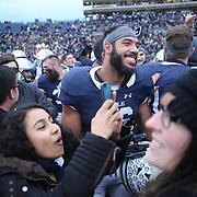 NEW HAVEN, CONNECTICUT - NOVEMBER 18: J. Hunter Roman #36 of Yale with fans after the Yale V Harvard, Ivy League Football match at the Yale Bowl.  The game was the 134th meeting between Harvard and Yale, a historic rivalry that dates back to 1875. New Haven, Connecticut. 18th November 2017. (Photo by Tim Clayton/Corbis via Getty Images)