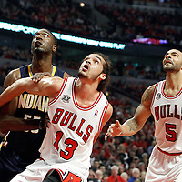 16 April 2011: Chicago Bulls center Joakim Noah (13) vies for the rebound with Indiana Pacers center Roy Hibbert (55) during the Chicago Bulls 104-99 victory over the Indiana Pacers, during the game 1 of the Eastern Conference first round at the United Center, Chicago, Illinois, USA.