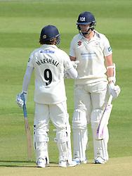 James Fuller of Gloucestershire cricket speaks with Hamish Marshall - Photo mandatory by-line: Dougie Allward/JMP - Mobile: 07966 386802 - 29/04/2015 - SPORT - Cricket - Bristol - County Ground - Gloucestershire Cricket v Derbyshire Cricket - LV=County Cricket 2