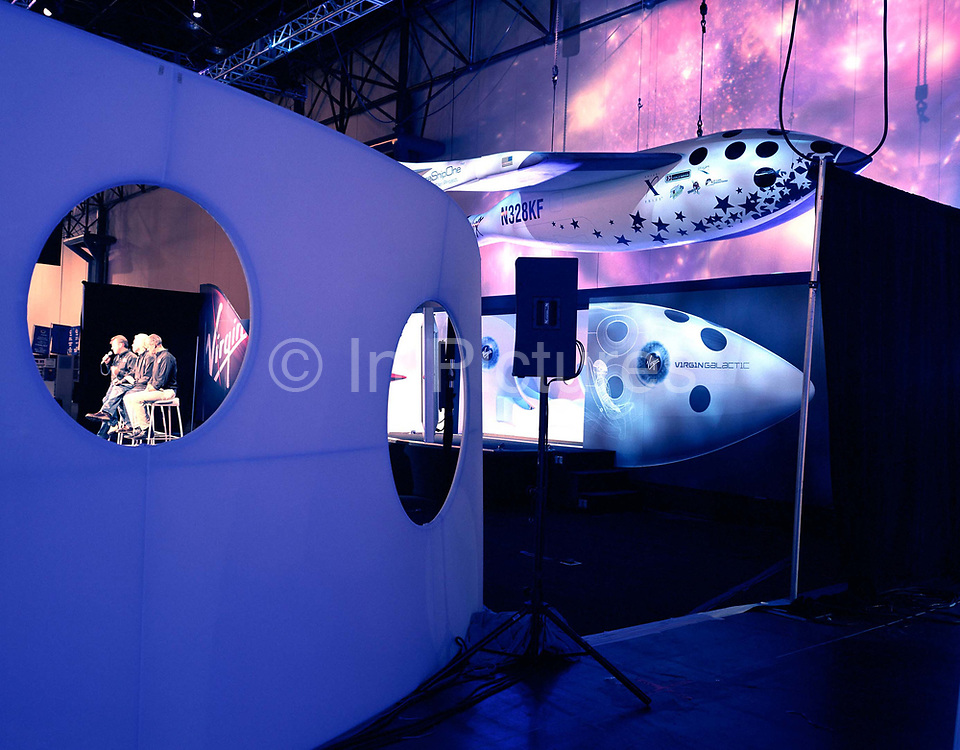 Virgin boss, Sir Richard Branson and Virgin Galactic directors Will Whitehorn and Stephen Attenborough, talk to the media during the unveiling of their SpaceShipTwo concept model's unveiling at the New York Wired NextFest at the Jacob K. Javits Convention Center.  Now under construction by Burt Rutan in Mojave, California and looking more like a Stanley Kubrick movie set from '2001 A Space Odyssey,' than the future for everyday holidays, SpaceShipTwo is a re-usable orbiting vehicle that will become an important tool for Man's leisure time in space when affordable commercial space tourism starts in around 2009.  <br /> Aboard the re-usable space vehicle will be 6 passengers, each of whom will have paid $200,000 for the 40 minute flight to 360,000 feet (109.73km, or 68.18 miles) and to experience just 6 minutes of weighlessness.<br /> Launched in September 2004 by Sir Richard Branson, Virgin Galactic will invest up to $250 million to develop the world's first commercial space tourism business with the building, testing and flying of five space shipShipTwos and two mother ships.  It is expected that within the first full year of commercial operations Virgin Galactic will enable 500 people to fulfil their dreams of becoming astronauts; in the last 4 decades the world has seen fewer than 500 astronauts. Flights start around 2009.<br /> 28/09/2006