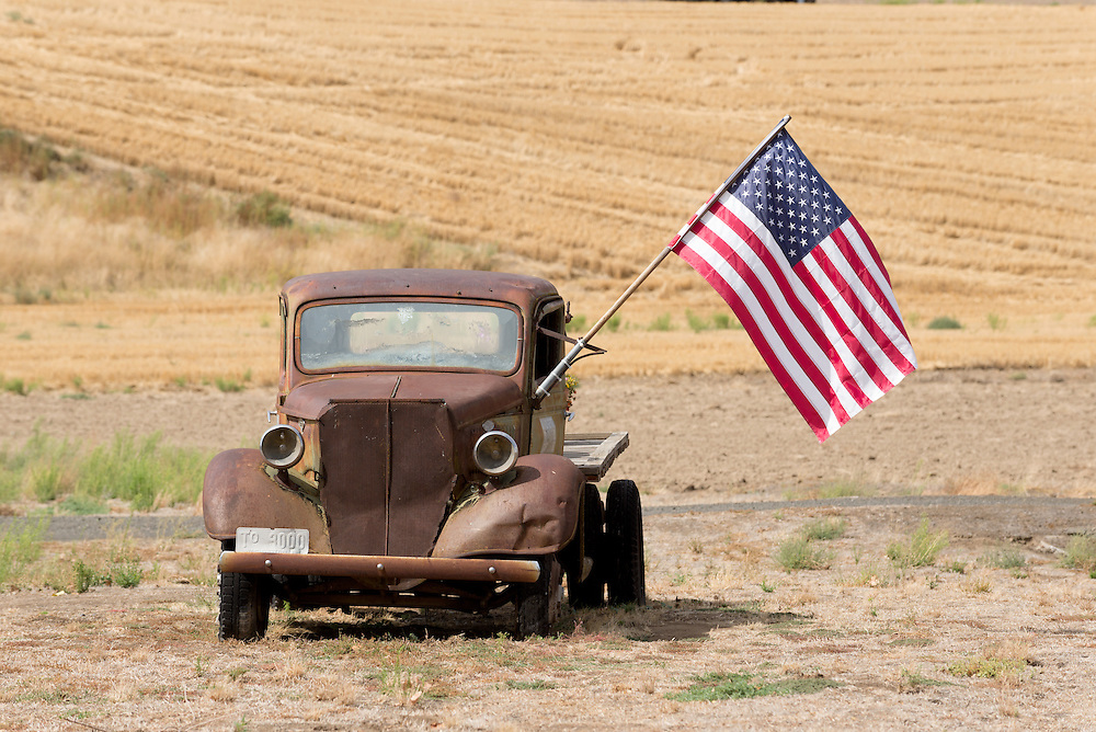 Old Ford flatbed truck with an American flag on a farm in Eastern Washington.