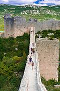 Tourists on the Great Wall above Mali Ston, Ston, Dalmatian Coast, Croatia