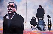 Street art, mural on main street building, Ushuaia, Argentina.